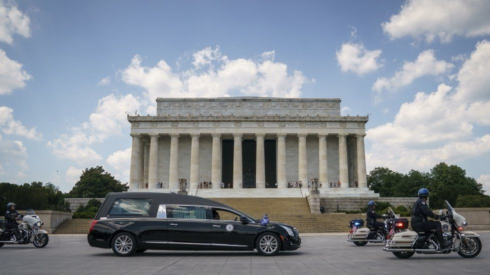 A hearse carrying the flag-draped casket with the body of Rep. John Lewis (D-GA) stops in front of the Lincoln Memorial before heading to the U.S. Capitol where he will lie in state July 27, 2020 in Washington, DC