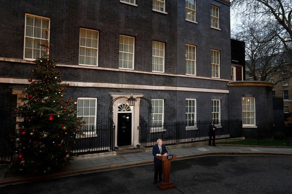 Britain's Prime Minister Boris Johnson delivers a speech outside 10 Downing Street i