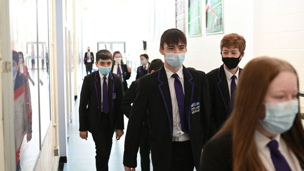 A Year 9 class walk along a corridor at Park Lane Academy in Halifax, northwest England on March 4, 2021.