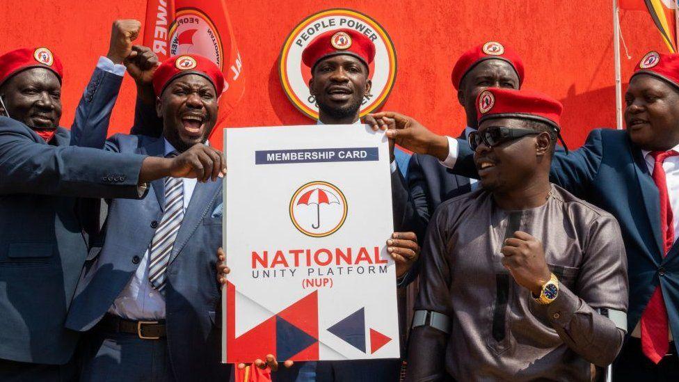 Ugandan singer turned politician Robert Kyagulanyi (C) aka Bobi Wine announces the membership of his new political party called National Unity Platform (NUP)