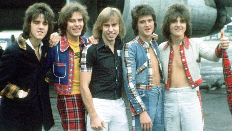 (Left to right) Stuart Wood, Alan Longmuir, Derek Longmuir, Les McKeown and Eric Faulkner of The Bay City Rollers at Heathrow Airport, London in 1975