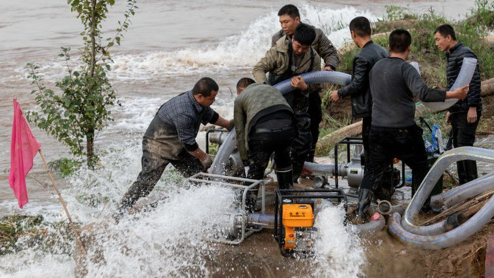 Rescue teams pump water at flooded Jiexiu Fenhe wetland park in Jinzhong, Shanxi Province of China.