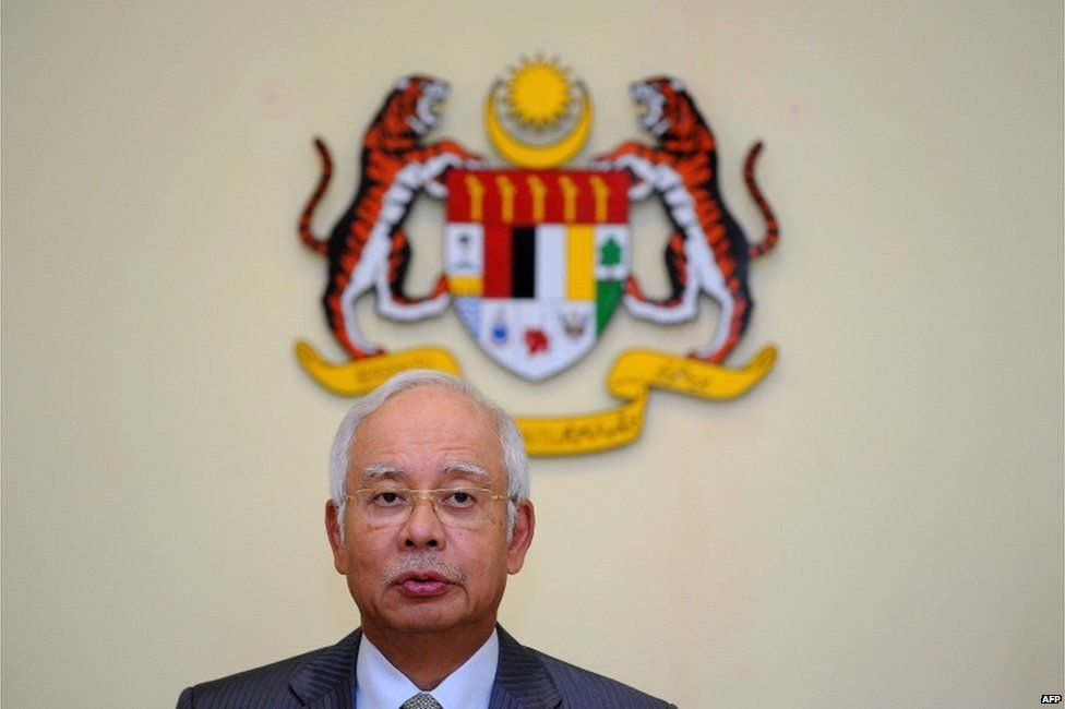 This file picture taken on 28 July 2015 shows Malaysia's Prime Minister Najib Razak addressing a press conference at his office in Putrajaya.