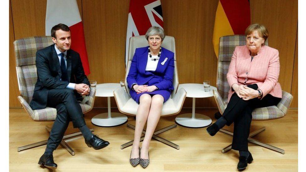 Prime Minister Theresa May (C), German Chancellor Angela Merkel (R) and French President Emmanuel Macron (L)