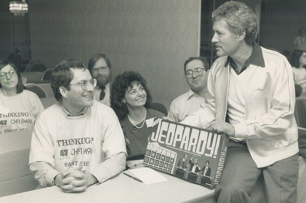 Trebek speaks to contestants from Canada before a taping