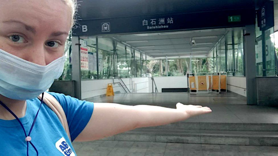 Jen Smith in front of an empty Metro station