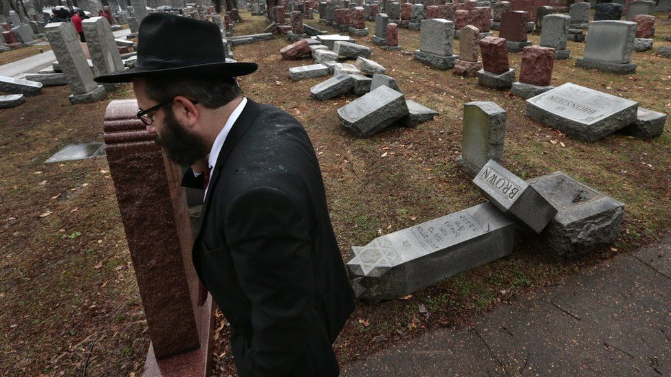 A man visits the Chesed Shel Emeth Cemetery in St Louis, Missouri, which was vandalised on Monday, 21 February 2017