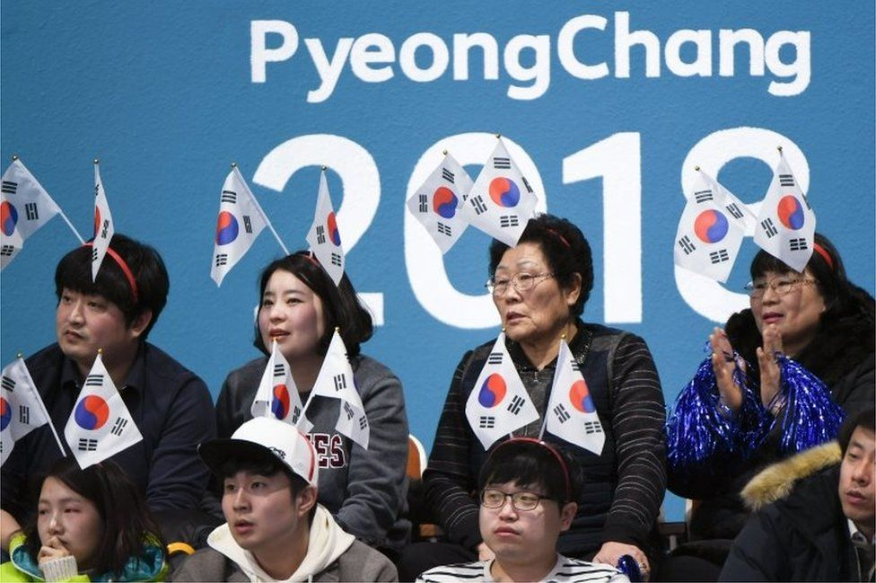 """South Korea fans watch the curling women""""s round robin session between South Korea and Britain during the Pyeongchang 2018 Winter Olympic Games at the Gangneung Curling Centre in Gangneung on February 17, 2018."""