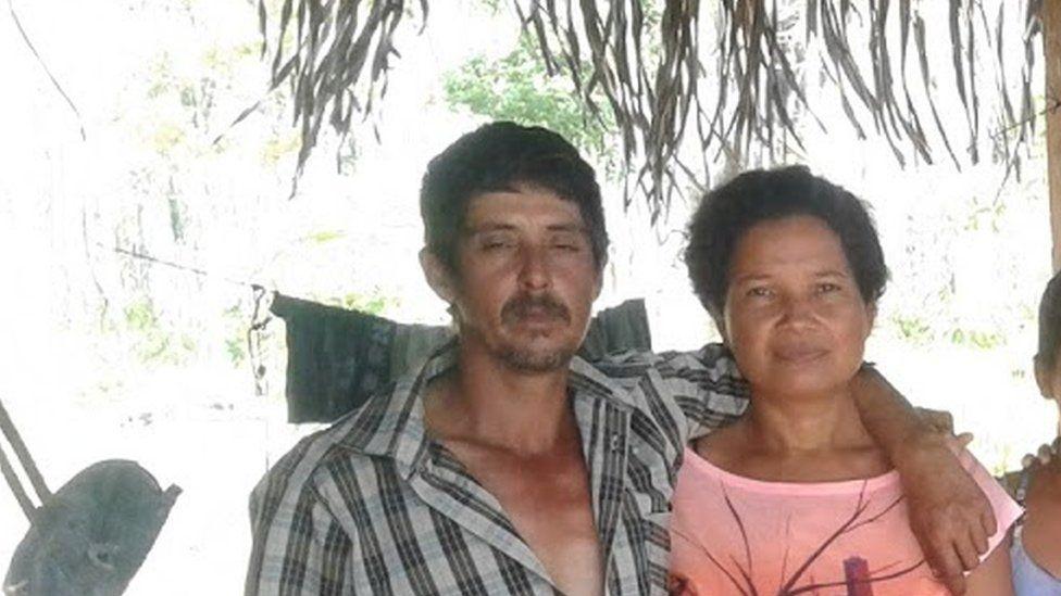 Farmers Eidi and Romildo in a family picture