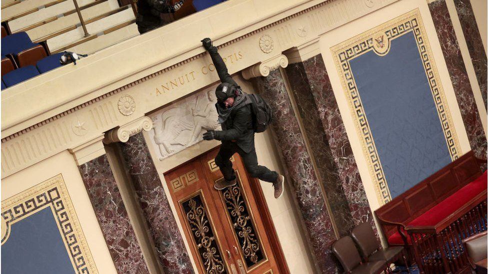 Officials have named the dangling rioter above as Josiah Colt of Idaho
