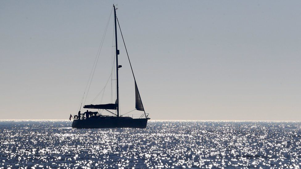 A sailing boat off the coast of Dungeness, Kent