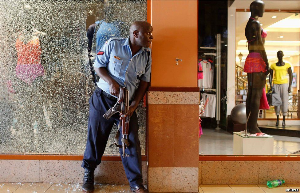 police officer tries to secure an area inside the Westgate Shopping Centre where gunmen went on a shooting spree in Nairobi September 21, 2013.
