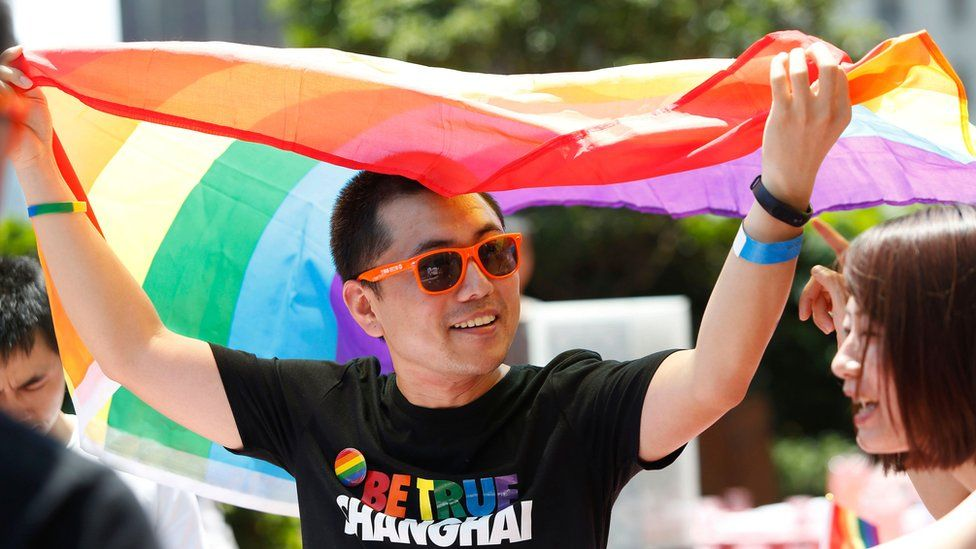 A man holds a rainbow flag at a pride festival in Shanghai in 2007