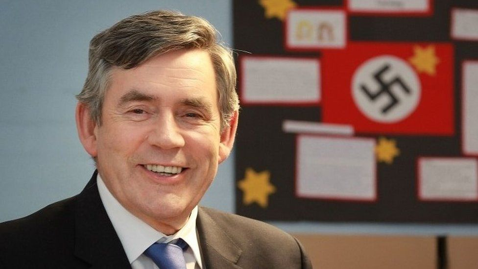 Gordon Brown next to a swastika