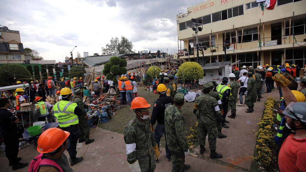 A schoolyard built for children to play in brims with rescue workers hoping to free anyone left alive in the ruins of collapsed classrooms at Enrique Rébsamen school, Mexico City, 20 September 2017