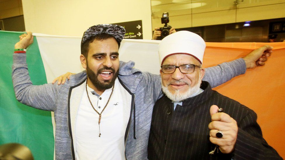 Ibrahim Halawa with his father at Dublin Airport