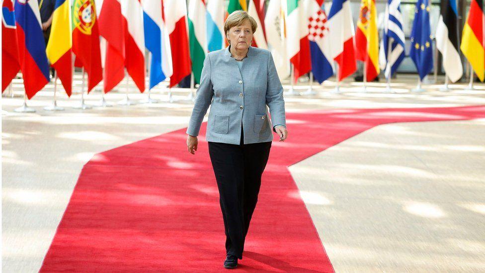 Angela Merkel arriving at talks in Brussels (29 April)