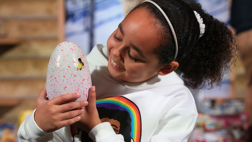 Girl with toy hatchimals egg