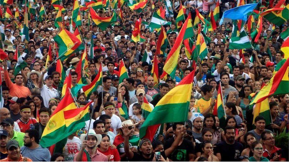 Bolivians celebrate the resignation of President Evo Morales, in La Paz, Bolivia, 10 November 2019.