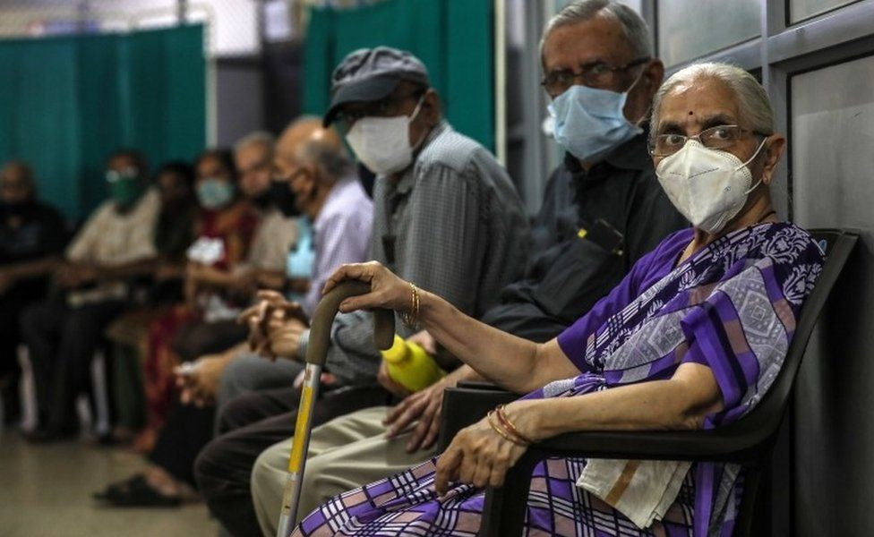 Senior citizens waits to get their first dose of a Covid-19 vaccine shot, manufactured by Serum Institute of India, inside a Vaccination Centre at Shatabdi Hospital in Mumbai, India, 12 March 2021.