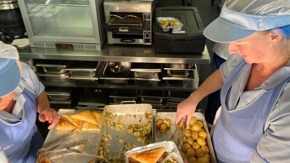 catering staff preparing meals