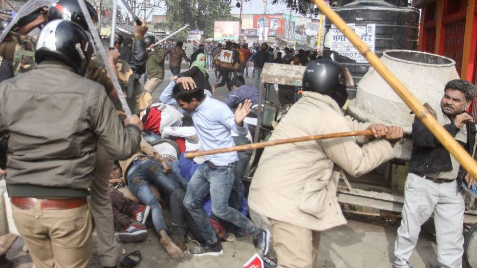 In this photo taken on December 19, 2019 police beat protesters with sticks during a demonstration against India's new citizenship law in Lucknow