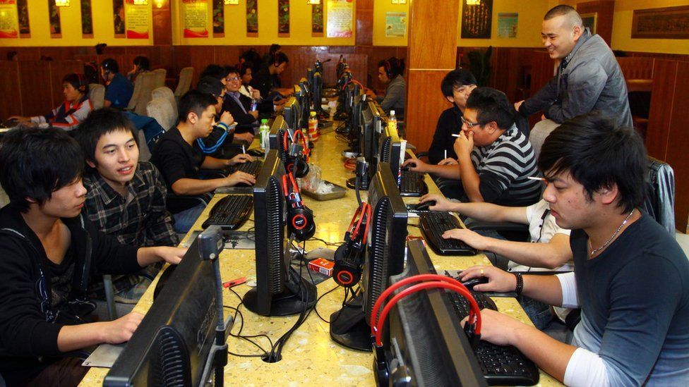 A group of people at an Internet cafe in Jiashan, east China's Zhejiang province, November 2012
