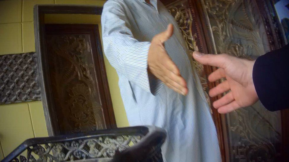 Two anonymous hands reaching out to each other for a handshake