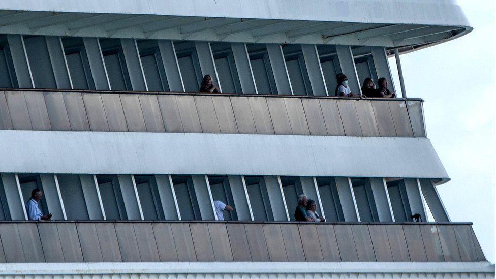 Passengers on board Holland America's cruise ship Zaandam as it entered the Panama City bay, 27 March 2020