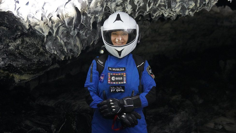 M.Musilova exploring a lava tube while outside the simulated spacecraft