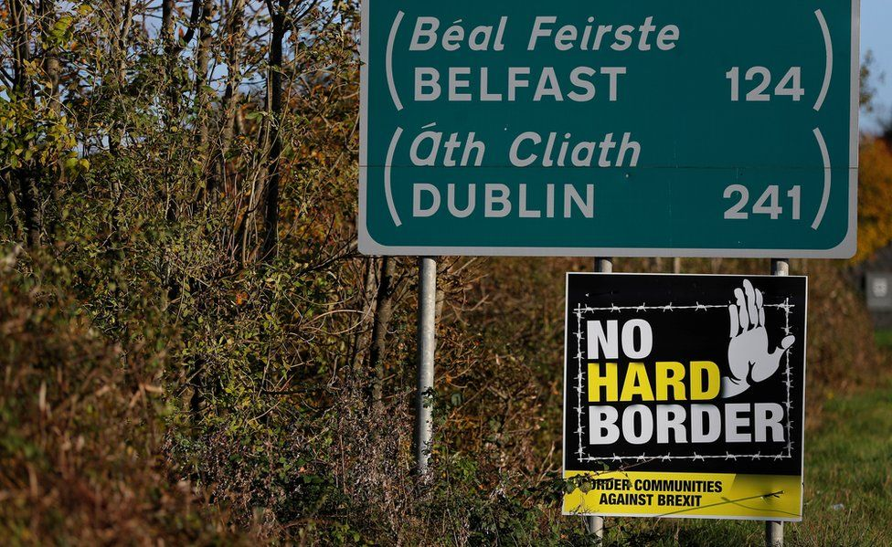 Road signs on the Irish border listing the distances to Belfast and Dublin