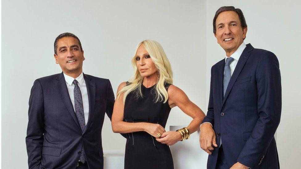 Donatella Versace with Versace chief Jonathan Akeroyd (left) and Michael Kors chief executive John Idol