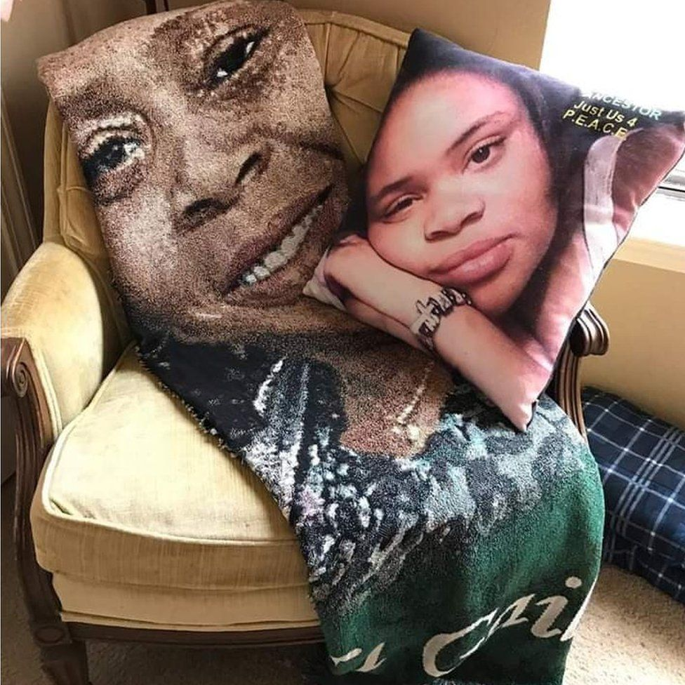 A blanket and cushion printed with pictures of Yolanda Carr and her daughter, Atatiana