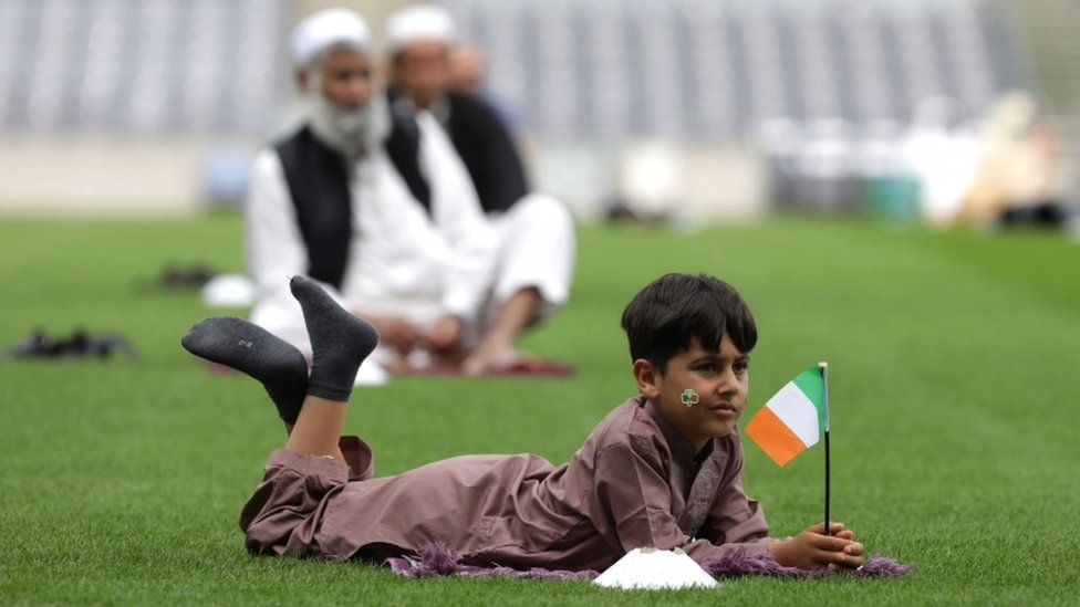 A six-year-old boy holds an Irish flag during the Eid celebration in Croke Park