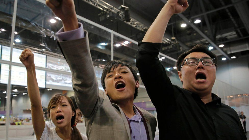 Candidates from Youngspiration celebrate after the party wins seats in the Hong Kong LegCo elections (5 September 2016)