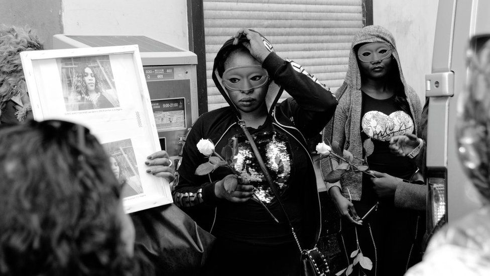 Women in masks protest the death of Eunice Osayande