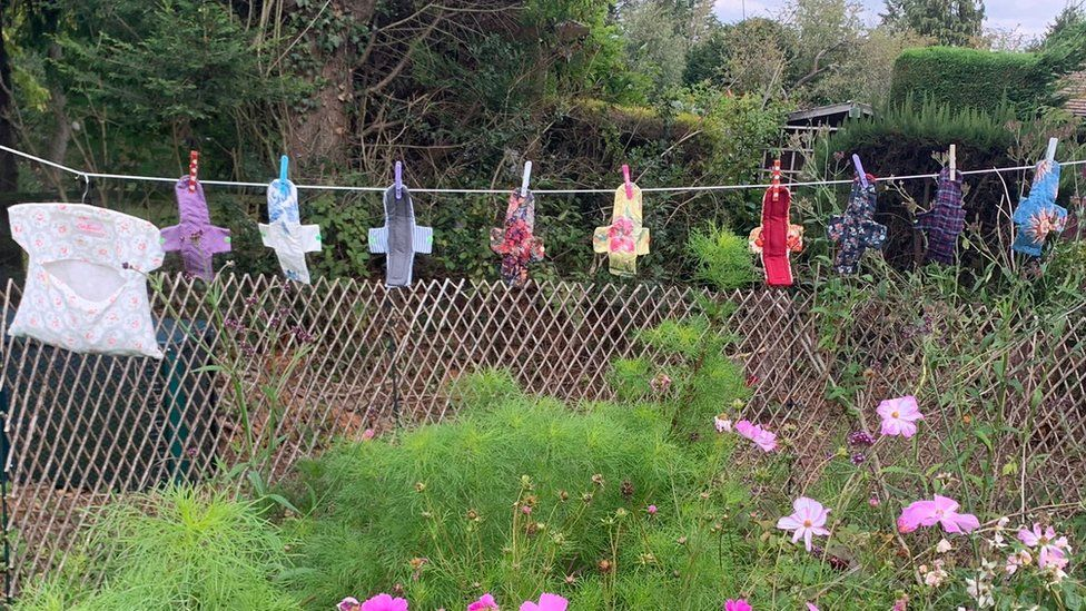 sanitary pads on a washing line