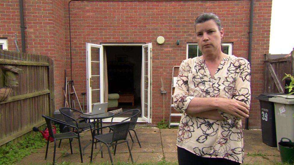 Lisa Harding outside her house