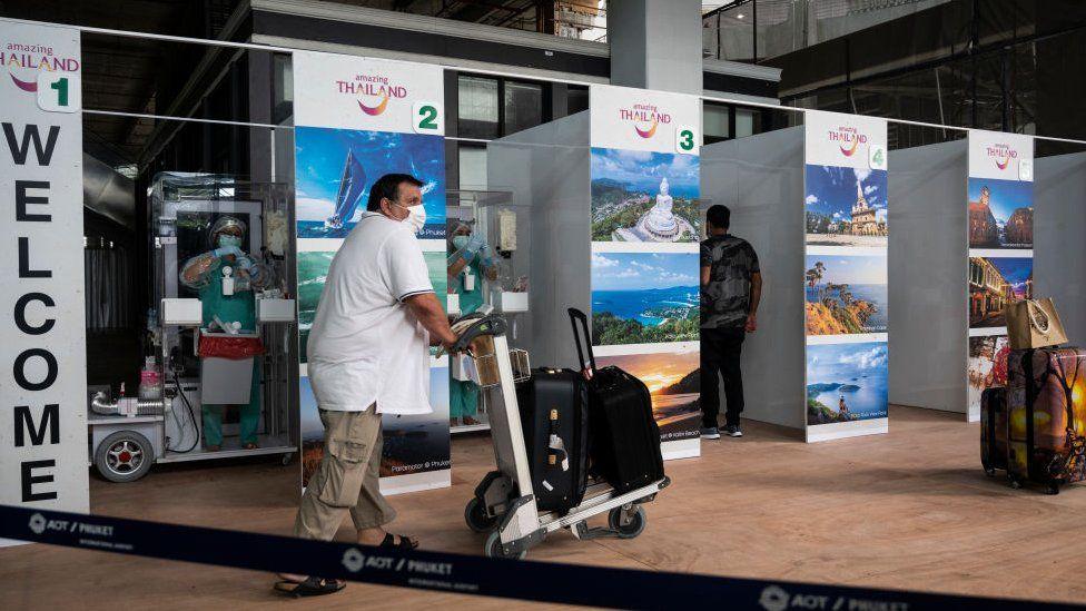 International passengers receive covid-19 coronavirus swab testing at the testing booth after arriving Phuket International Airport
