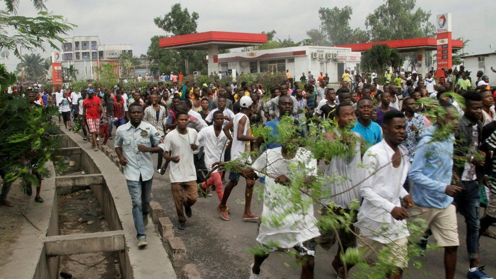 Congolese opposition supporters chant slogans during a march to press President Joseph Kabila to step down
