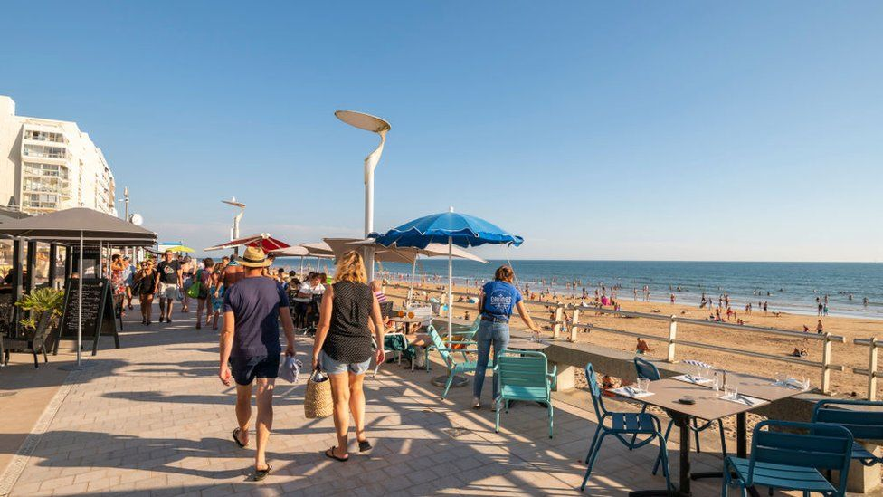 Saint-Gilles-Croix-de-Vie (central-western France): holidaymakers on the embankment and the main beach, on the coast of the Vendee department.