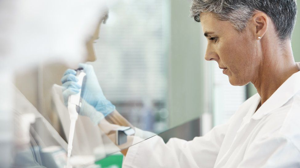 Scientist conducting cancer research in laboratory