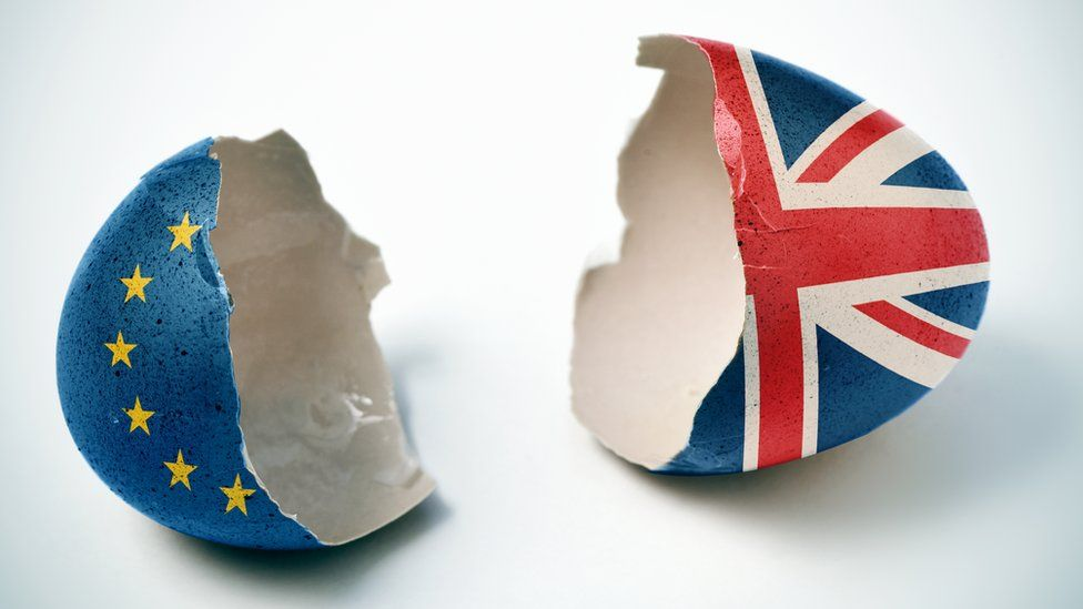 A cracked egg, decorated with the EU and UK flags
