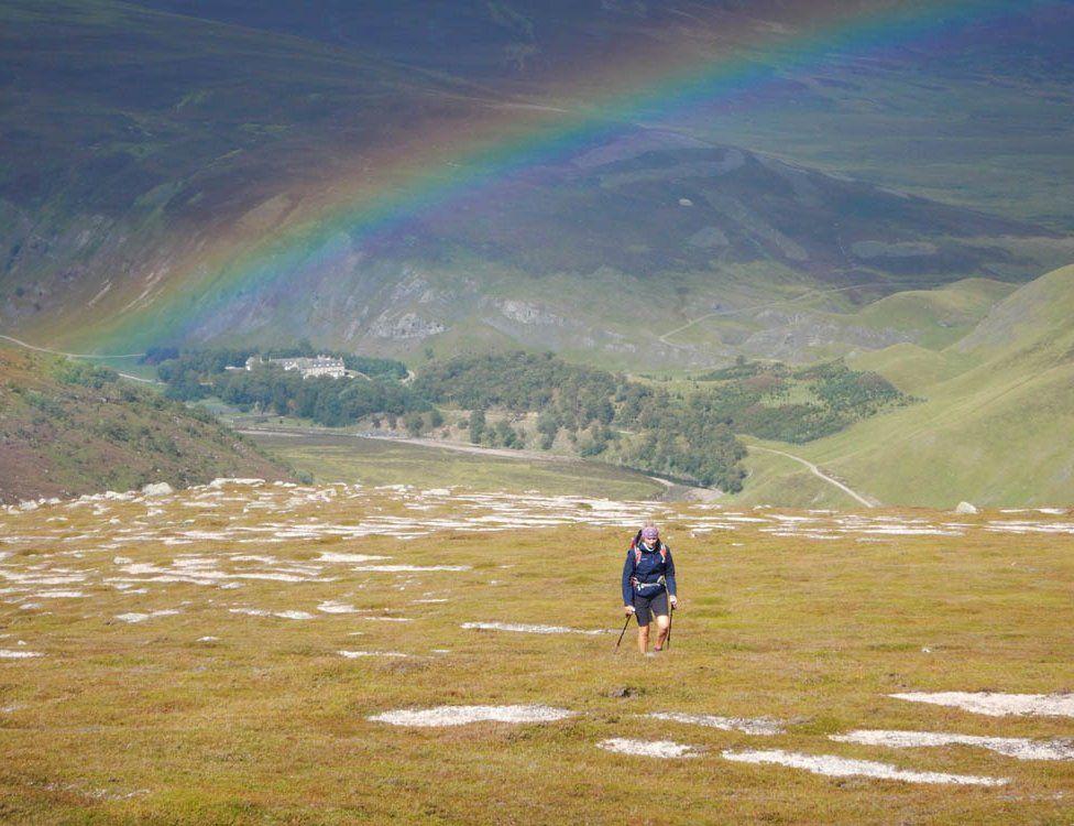 Walker and rainbow