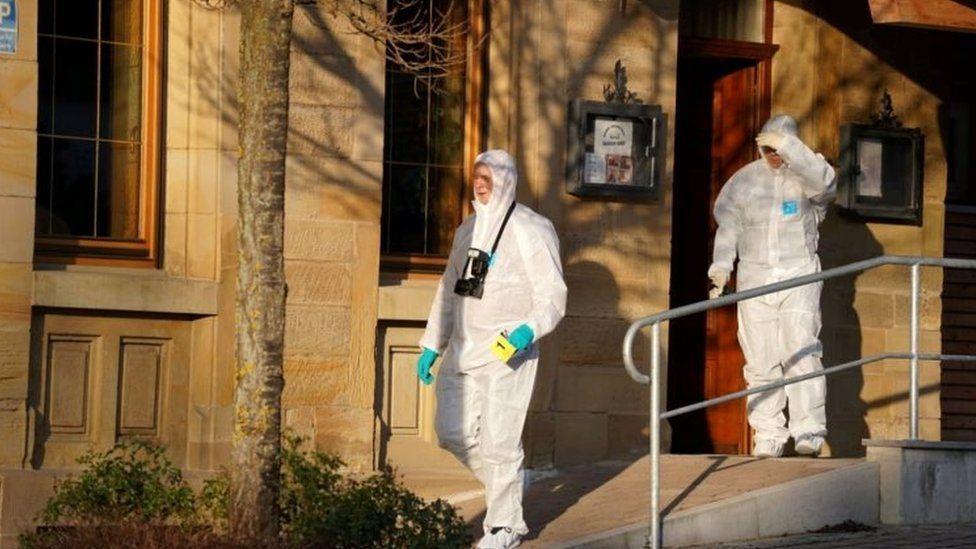 Forensic experts examine the area after the shooting in Rot am See, Germany. Photo: 24 January 2020