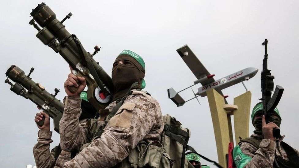 Members of Hamas's military wing, the Izzedine al-Qassam Brigades, attend a memorial in the southern Gaza Strip town of Rafah (31 January 2017)