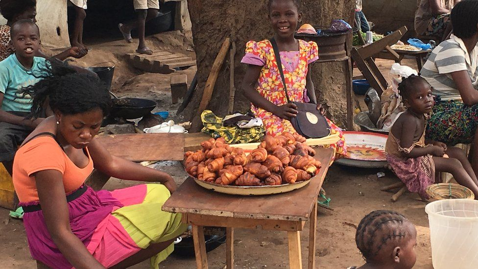 People in Benzvi displaced camp are selling some croissants and other food to earn a living, Bangui, CAR