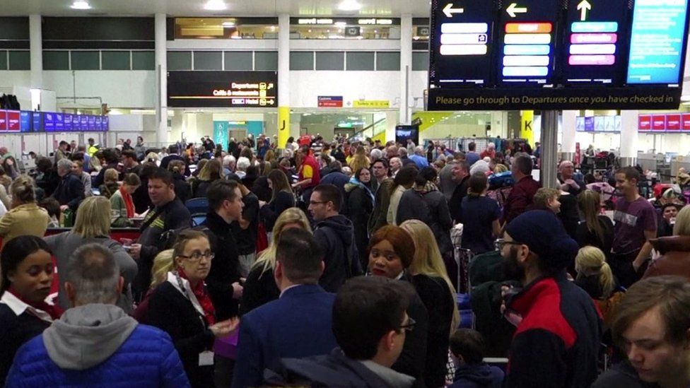 Gatwick Airport passengers queuing at check in