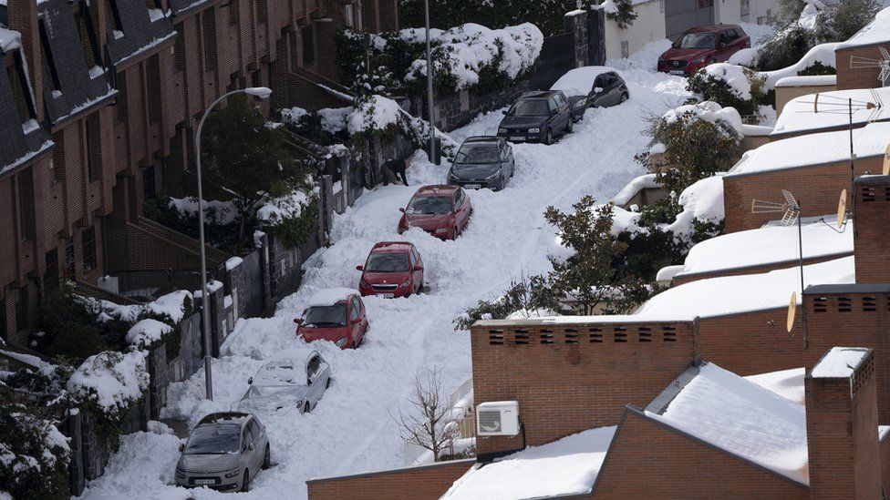 Cars covered by snow after the Storm Filomena in Madrid, Spain