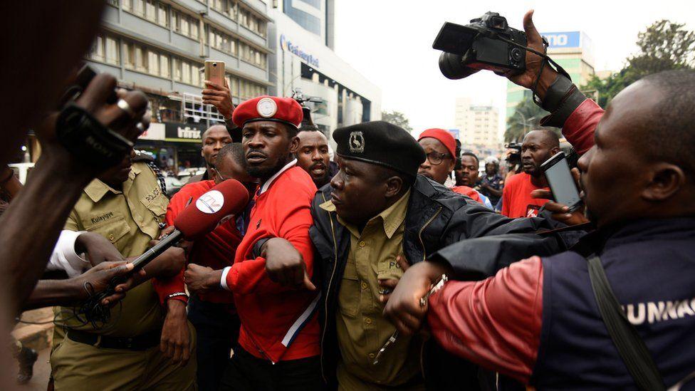 Police taking away Bobi Wine during demo